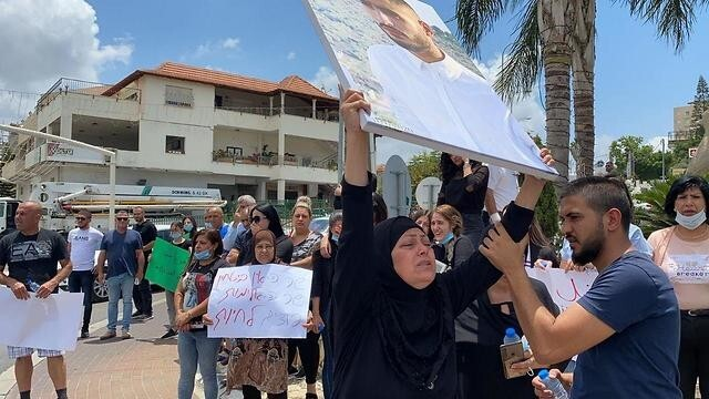 Residents of the town of Kafr Yasif protest gun violence in the Arab community