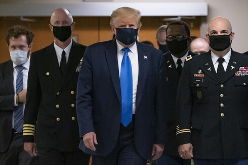 U.S. President Donald Trump wears a mask while visiting Walter Reed National Military Medical Center