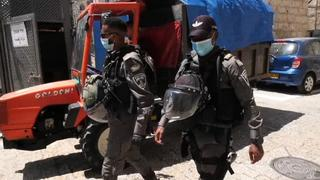 Border Police look for cameras in the area where the Palestinian man was shot