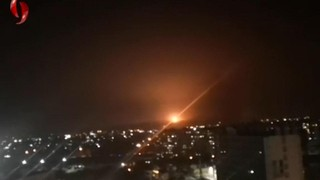 Syrian air defenses operate over Damascus during strike attributed to Israel
