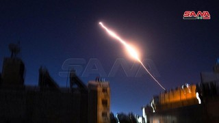 Syrian air defenses are triggered during an air strike attributed to Israel last week