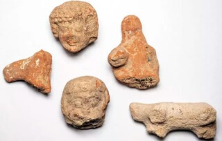 Clay figurines of women and animals found at the excavation site in the Arnona neighborhood of Jerusalem near the US Embassy