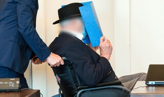 Bruno Dey, 93-year-old former SS security guard from the Stutthof concentration camp near Gdansk sits in a courtroom behind a plexiglass window in the regional court on July 23, 2020 in Hamburg
