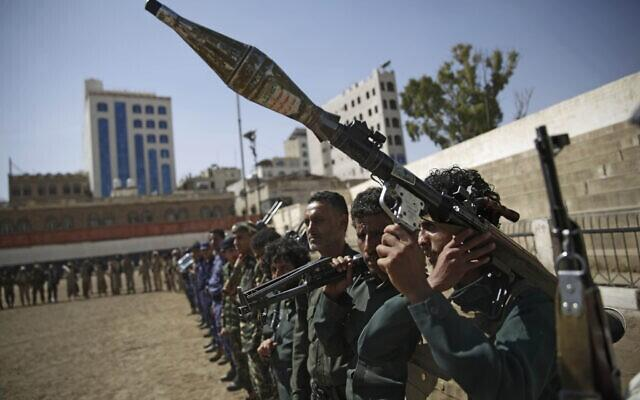 Houthi rebel fighters display their weapons during a gathering aimed at mobilizing more fighters for the Iranian-backed Houthi movement, in Sanaa, Yemen