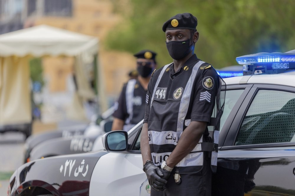 Policemen wearing gloves and face masks to help prevent the spread of the coronavirus, provide security for pilgrims, in Mecca, Saudi Arabia
