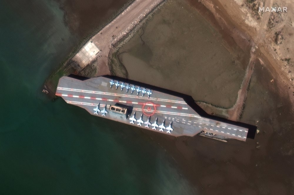 A mockup aircraft carrier built by Iran is seen at Bandar Abbas, before being put to sea
