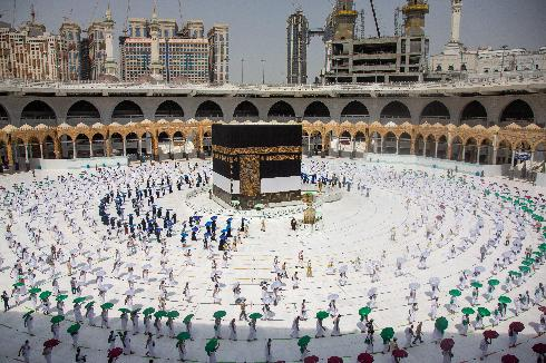 Pilgrims circle around the Kaaba at the Grand Mosque in Mecca on the first day of Hajj, July 29, 2020