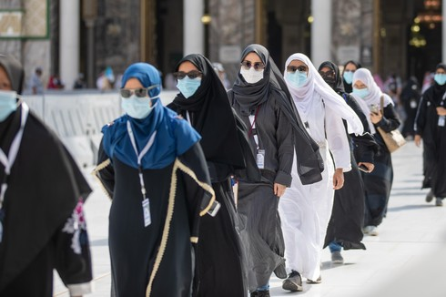Pilgrims wear masks and maintain social distancing as they enter the Grand Mosque in Mecca on the first day of Hajj, July 29, 2020
