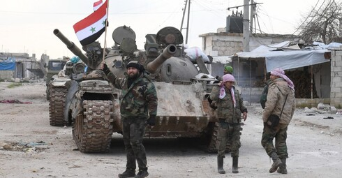 Syrian government forces deploy near the Damascus-Aleppo highway in the southern part of Syria's northern Aleppo province