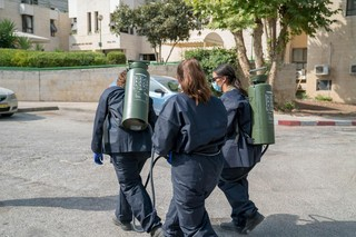 Security and health personnel spray disinfectants