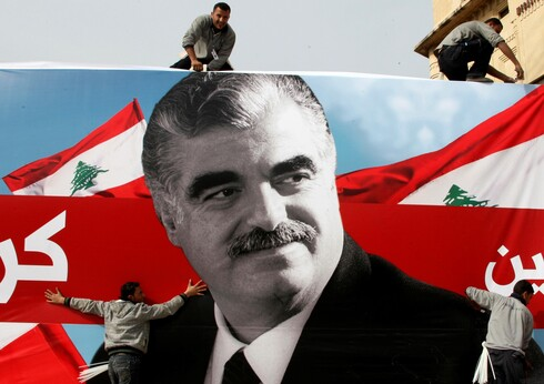 Workers prepare a giant poster depicting Lebanon's assassinated former prime minister Rafik al-Hariri, in downtown Beirut, Lebanon February 12, 2010