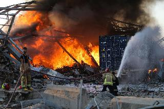 Firefighting teams try to extinguish fires after Beirut explosion