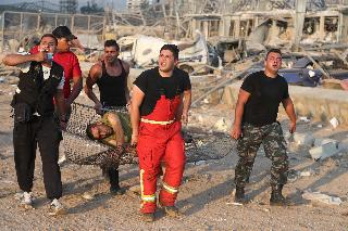 Rescue teams evacuate a person injured in massive Beirut blast