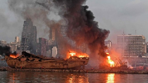 A ship is pictured engulfed in flames at the port of Beirut