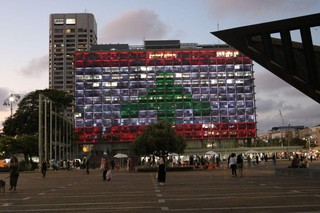 Tel Aviv city hall lights up in the colors of the Lebanese flag
