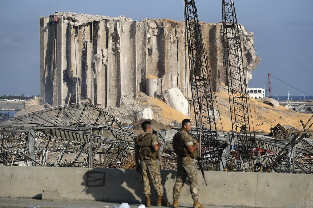 Lebanese army soldiers stand guard at the scene where an explosion hit on Tuesday the seaport of Beirut, Lebanon