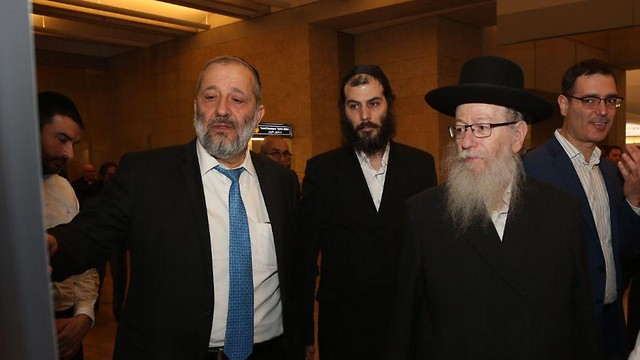 Interior Minister Aryeh Deri and Construction and Housing Minister Yaakov Litzman