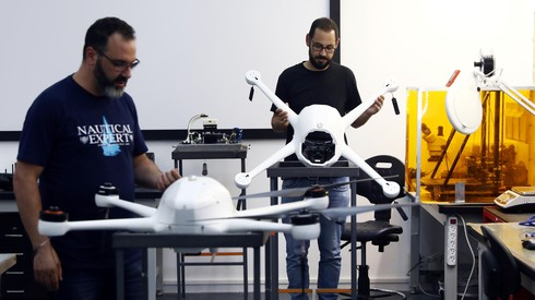 Employees of Airobotics, an Israeli company which says it has developed two pilotless drones that are being trialled by Singapore's police