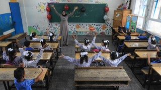 Palestinian students attend a class at a school run by The United Nations Relief and Works Agency (UNRWA) in Jabalia refugee camp in northern Gaza Strip