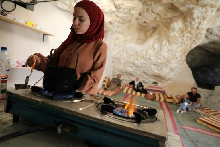The wife of Ahmed Amarneh prepares coffee at his home