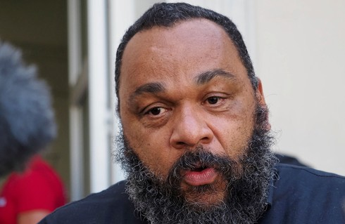 """Dieudonne MBala MBala speaks to medias outside the courthouse of Chartres prior to a hearing of his trial for alleged """"racist and antisemitic comments"""""""