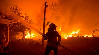 A fire fighter battling wildfires in California