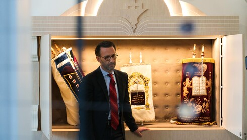 Ross Kriel, the president of the Jewish Council of the Emirates, in front of the community's Torahs in Dubai, Aug. 16, 2020