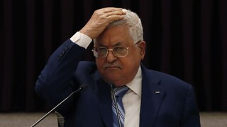 President Mahmoud Abbas gestures during a meeting with the Palestinian leadership