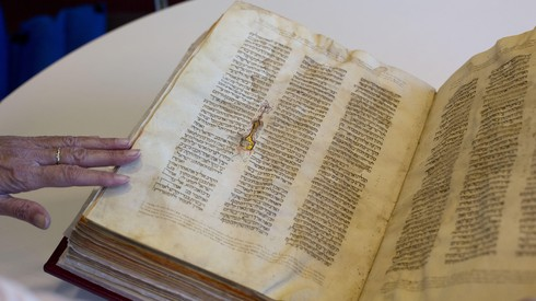A library official shows a Jewish manuscript smuggled into Israel from Damascus in a Mossad spy operation in the early 1990s