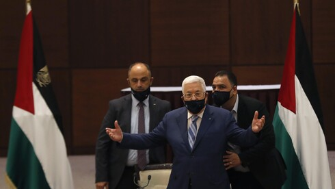 President Mahmoud Abbas gestures during a meeting with the Palestinian leadership to discuss the United Arab Emirates' deal with Israel to normalize relations,