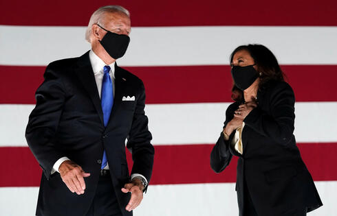Democratic presidential candidate and former Vice President Joe Biden and U.S. Senator and Democratic candidate for Vice President Kamala Harris celebrate after Joe Biden accepted the 2020 Democratic presidential nomination