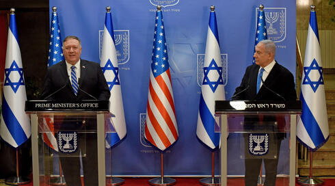 US Secretary of State Mike Pompeo (L) and Israeli Prime Minister Benjamin Netanyahu make a joint statement to the press after meeting in Jerusalem