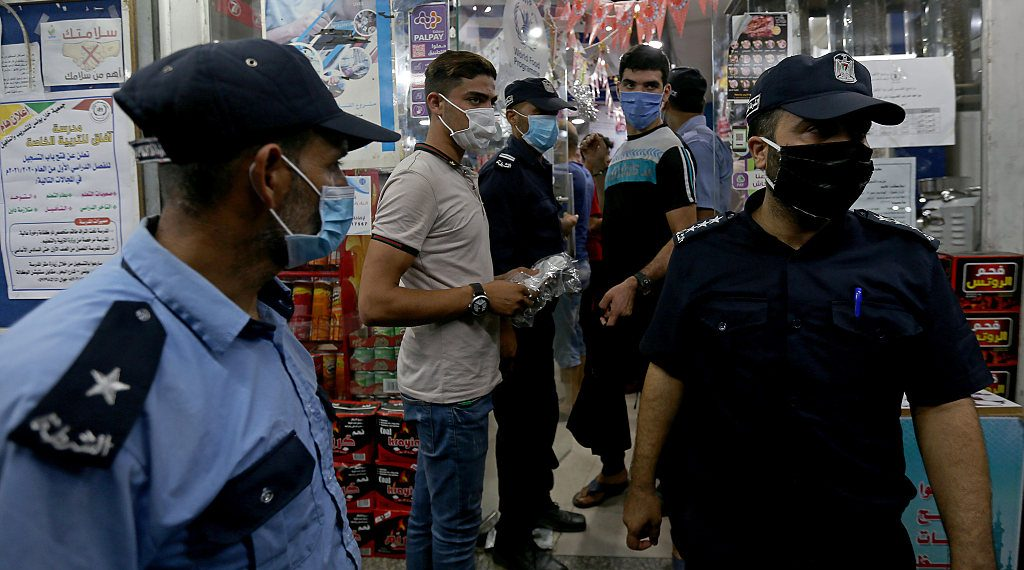 Police with face mask patrol Gaza streets