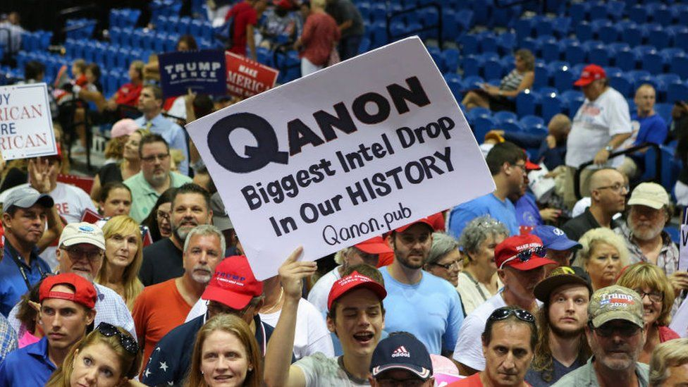 Supporters displaying QAnon posters appeared at Trump rallies last summer