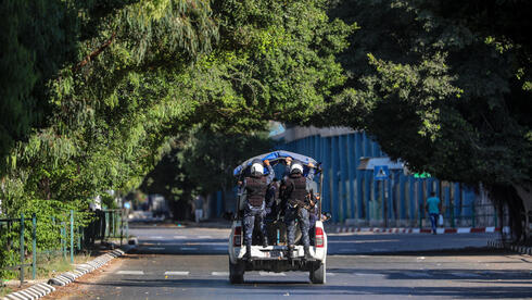 Palestinian Hamas policemen patrol on empty streets amid the ongoing coronavirus COVID-19 pandemic in Gaza