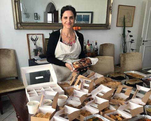 Elli Kriel with Shabbat food she prepared for hungry guests