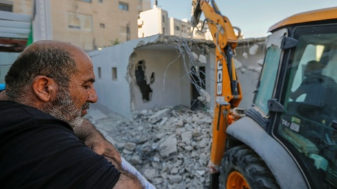 Palestinian home owner watches house built without permit razed in East Jerusalem