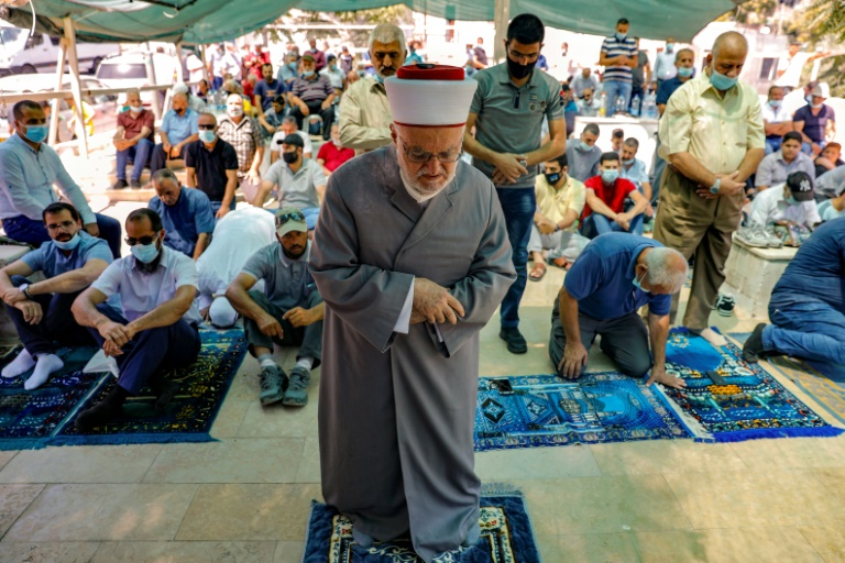 Palestinian Muslim cleric heads prayers in protest tent set up by activists against demolition of houses by Israeli authorities in East Jerusalem