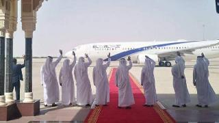 Emirati officials wave as the Israeli delegation leaves the UAE