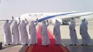 Emirati officials wave farewell as an El Al plane prepares to take off from Abu Dhabi for Tel Aviv on Tuesday