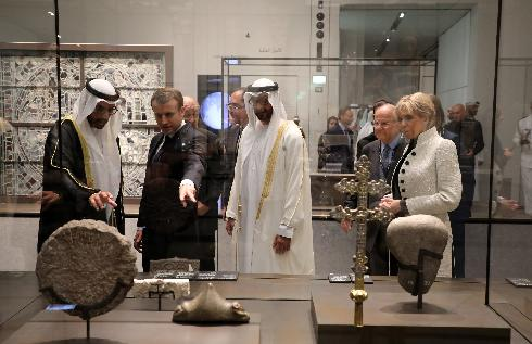 Abu Dhabi Crown Prince Mohammed bin Zayed al-Nahayan, 2nd right, Chairman of Abu Dhabi's Tourism and Culture Authority, Mohamed Khalifa al-Mubarak, left, French President Emmanuel Macron, 2nd left, and his wife Brigitte Macron visit the Louvre Abu Dhabi Museum