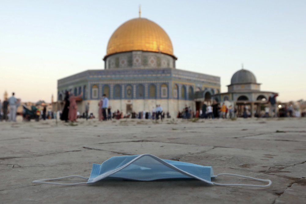 A protective face mask left on the ground during the Eid al-Adha prayers, on the Al Aqsa Mosque compound in Jerusalem's Old City