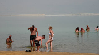 Holidaymakers at the Dead Sea during extremely hot September