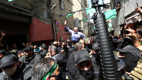 Palestinian group Hamas' top leader, Ismail Haniyeh, is carried during his visit at Ain el Hilweh Palestinian refugee camp in Sidon, Lebanon