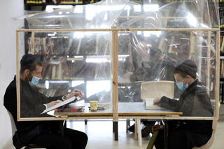 Ultra-Orthodox yeshiva students study in small, separate groups, also known as 'capsules'