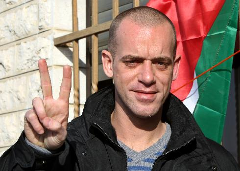 Salah Hamuri, a French-Palestinian, flashes a victory sign outside his home in Dahyat al-Barid near the West Bank city of Ramallah