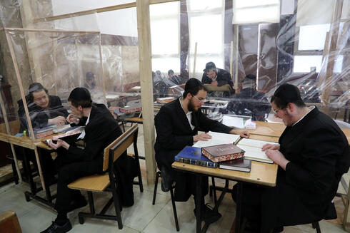 Young Haredi men studying at a yeshiva in Bnei Brak during the pandemic