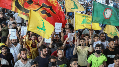 Supporters of the Shi'ite-aligned groups Hezbollah and Amal during a rally in Beirut