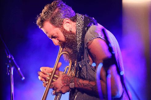 Avishai Cohen, the co-founder and artistic director of the event, performs on stage during the Jerusalem Jazz Festival