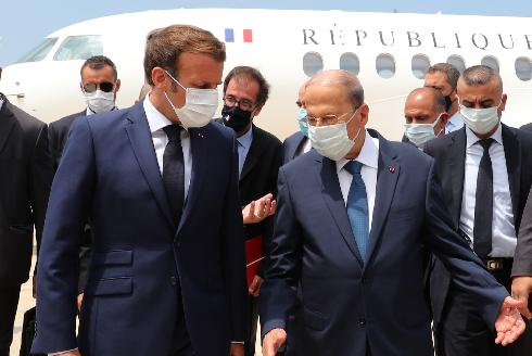 Lebanon's President Michel Aoun welcomes French President Emmanuel Macron upon his arrival at the airport in Beirut, Lebanon